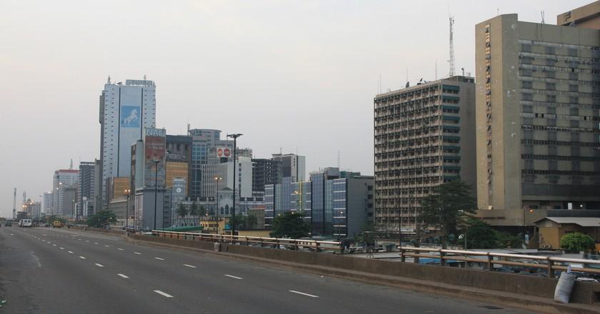 "<a href = ""https://www.flickr.com/photos/clarasanchiz/16569516980/in/photolist-6aDVTm-rfc78f-4sNd3B""> Lagos skyline | © Clara Sanchiz/Flickr"