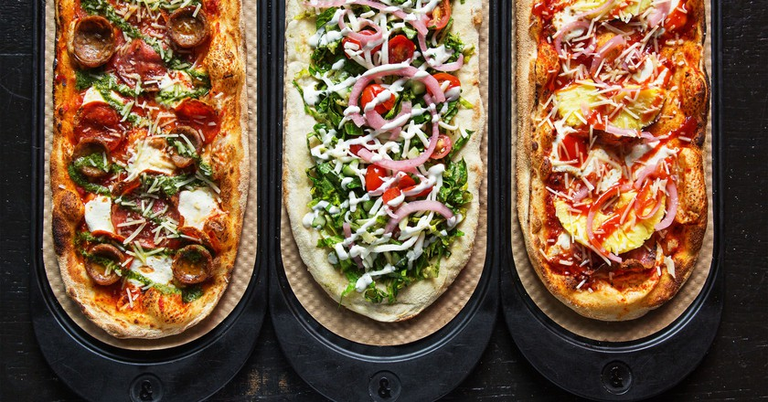 A few of &pizza's oblong pizzas | image courtesy of &pizza