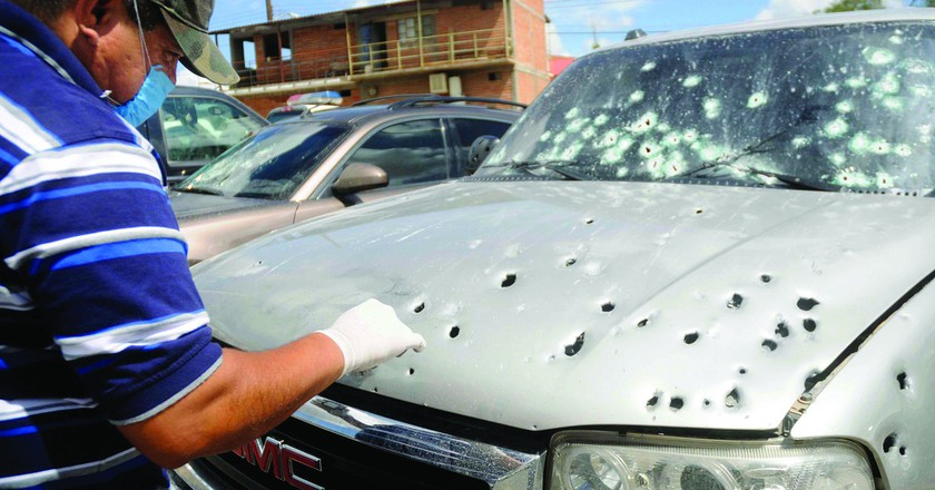 Drug violence in Mexico. This is the bullet ridden, drug-related hit remains of a car in Hermosillo, Sonora   © John S. and James L. Knight Foundation/Flickr
