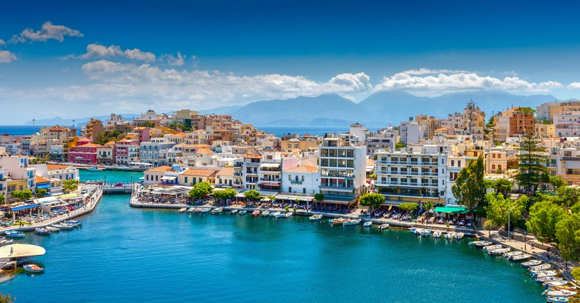 Agios Nikolaos, Crete, Greece. Agios Nikolaos is a picturesque town in the eastern part of the island Crete built on the northwest side of the peaceful bay of Mirabello   © photoff / Shutterstock