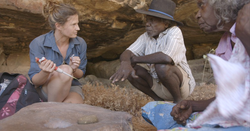 Elspeth Hayes with Mark Djandjomerr and traditional owner May Nango extracting comparative samples at a cave adjacent Madjedbebe Courtesy  © Gundjeihmi Aboriginal Corporation