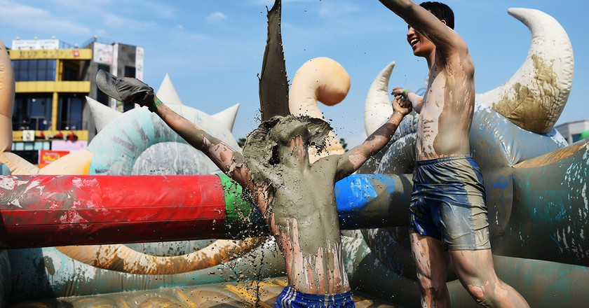 Getting dirty at Mudfest | © Boryeong Mud Festival Organization Committee