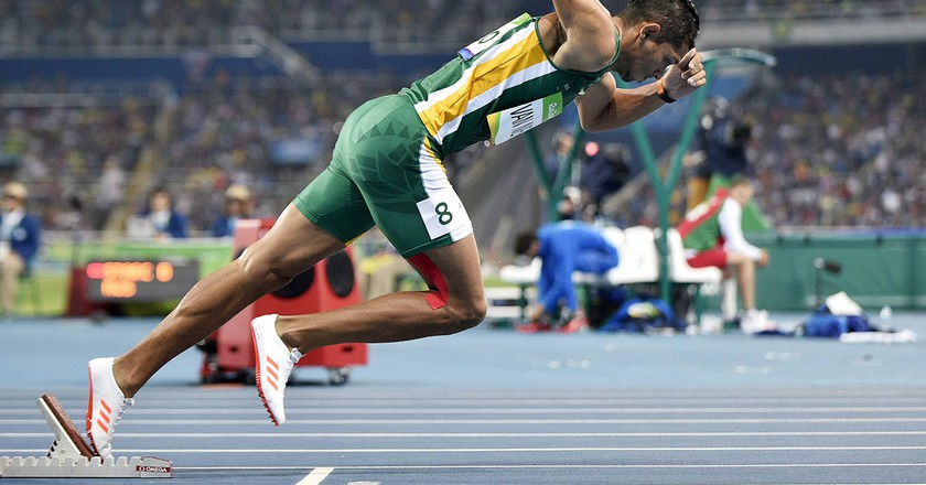 Wayde Van Niekerk at the start of the Men's 400-metre final at the Rio 2016 Olympic Games. He won the race in record-breaking time | © Franck Robichon / Rex Features