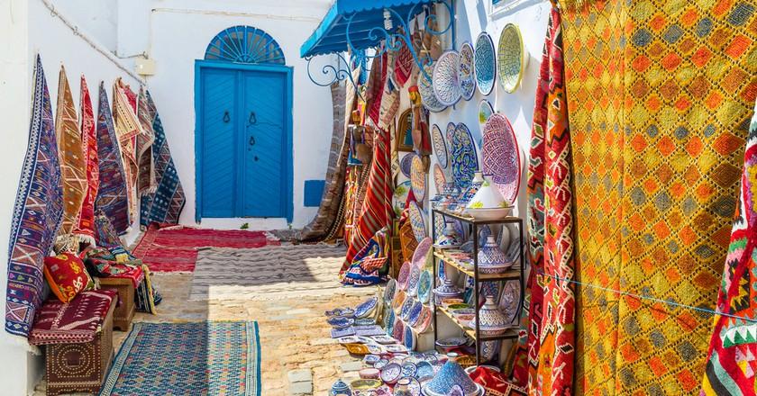 Colorful rugs for sale, Sidi Bou Said, Tunisia | © eFesenko/Shutterstock