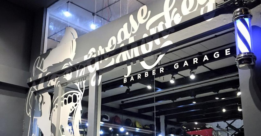 Exterior of Grease Monkey Barber Garage | © Facebook/Grease Monkey Barber Garage