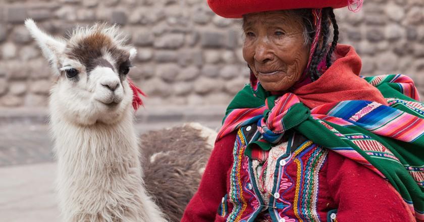 Woman with llama   © Geraint Rowland/Flickr