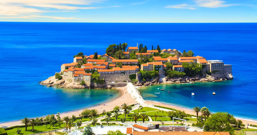 Beautiful view of the island-resort of St. Stefan (Sveti Stefan) on the Budva Riviera, Budva, Montenegro on a sunny day