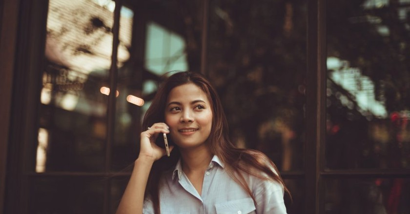 A woman on her phone | Chevanon Photography/Pexels