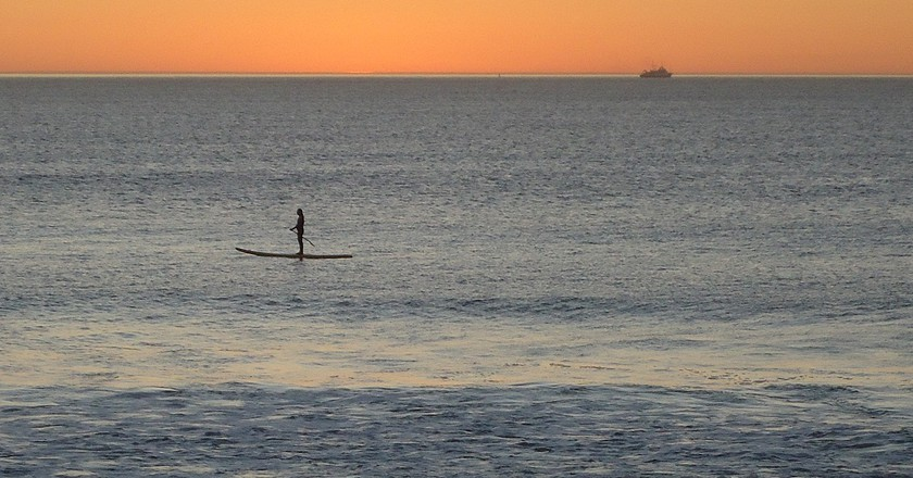Stand up paddle boarding at sunset   © Ian Barbour/Flickr