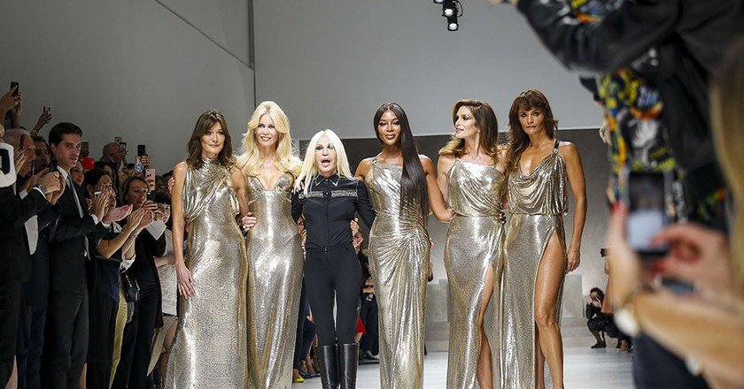 L-R: Carla Bruni-Sarkozy, Claudia Schiffer, Donatella Versace, Naomi Campbell, Cindy Crawford and Helena Christensen at Milan Fashion Week spring/summer 2018