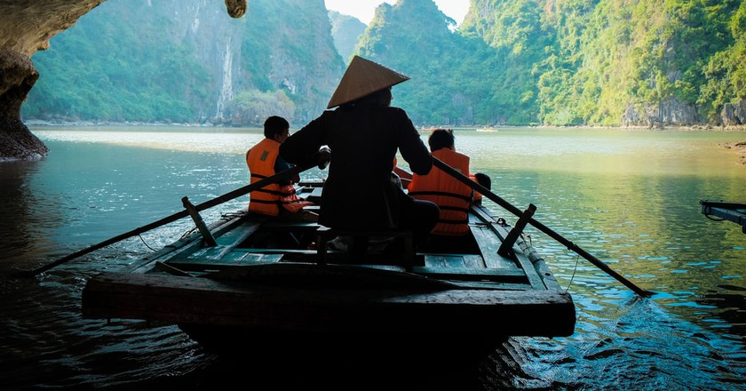 Boating through caves in Vietnam   © Pitikorn Ingmaneekan/Shutterstock