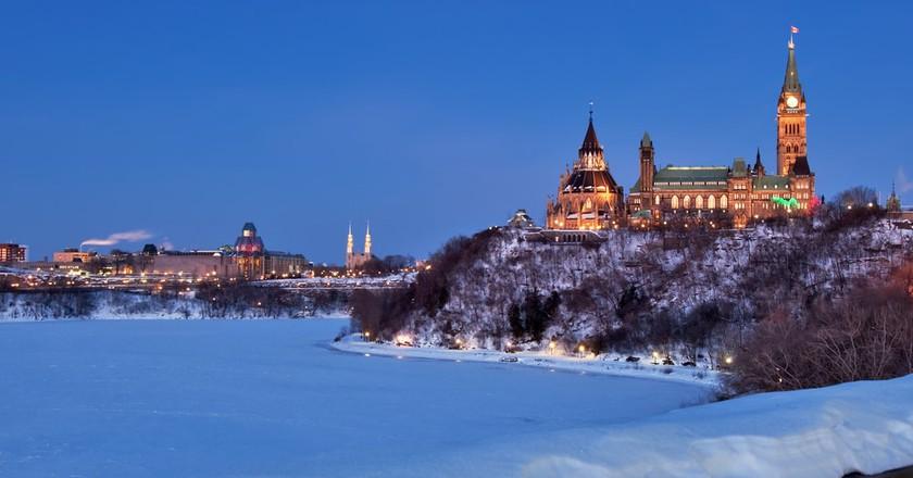 Ottawa's Parliament Buildings glowing in winter | © Howard Sandler / Shutterstock