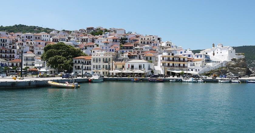 "<a href=""https://pixabay.com/en/skopelos-christos-town-greece-2304044/"" target=""_blank"" rel=""noopener noreferrer"">Skopelos, Greece, as seen in <em>Mamma Mia!</em> | tom_crew / Pixabay</a>"