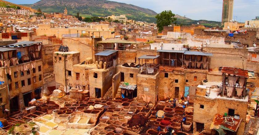 "<a href=""https://www.flickr.com/photos/alextorrenegra/4583770043/"" target=""_blank"">A tannery in Fez   © Torrenegra / Flickr</a>"