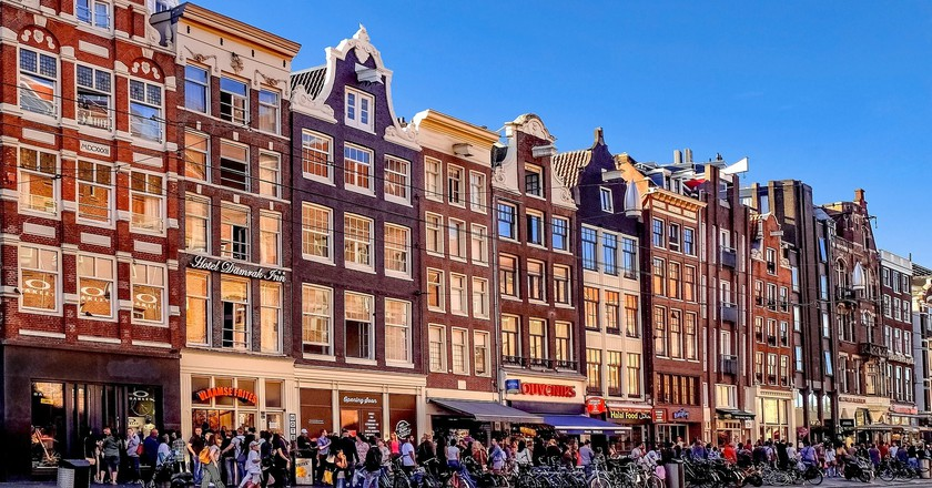 There are dozens of tourist stores on Damrak in Amsterdam