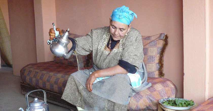 "<a href=""https://www.flickr.com/photos/chigley/3004283466/"" rel=""noopener"" target=""_blank"">A Moroccan lady preparing mint tea 