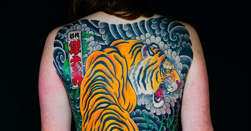 Japanese bodysuit tattoo by Kian Forreal | Courtesy of Authentink