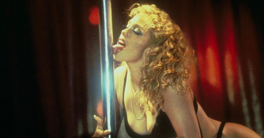 Elizabeth Berkley displays her pole dancing skills in Showgirls