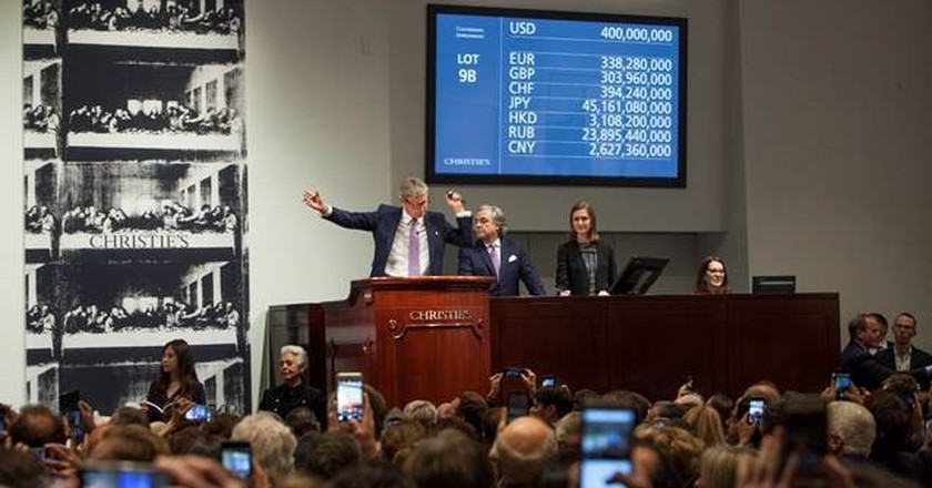 Auctioneer and Global President Jussi Pylkkänen selling Leonardo da Vinci's 'Salvator Mundi' for a record $450,312,500   © Christie's Images Ltd. 2017