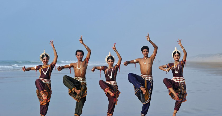 A group of dancers perform Odissi, one of India's classical dance forms   © Majority World / REX / Shutterstock