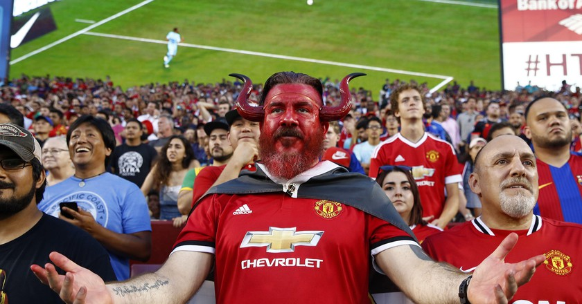 A Manchester United fan watches the club's International Champions Cup match against Barcelona | AP/REX/Shutterstock