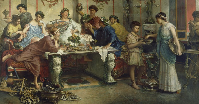 A Roman Feast by Roberto Bompiani | © WikiCommons