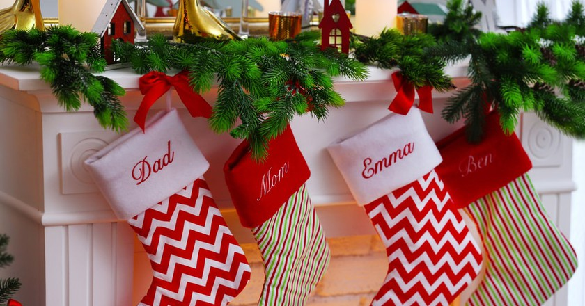 Christmas stockings with family members' names emblazoned on them   © Africa Studio/Shutterstock