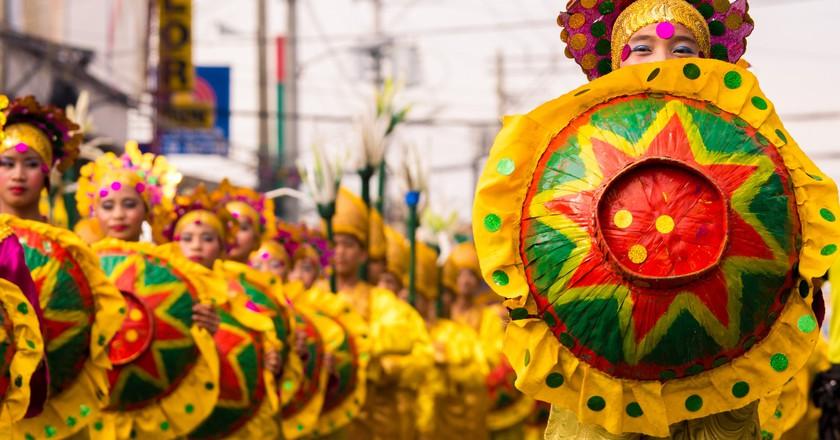 Dancers in costume at Kadayawan Festival, Philippines
