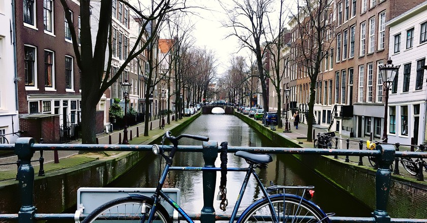 A bike chained to a bridge on Amsterdam's canals