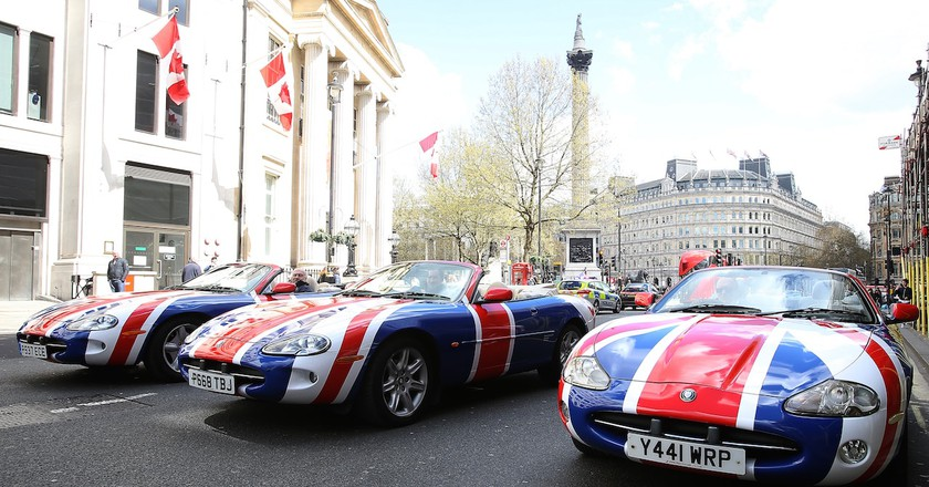 Jaguars adorned with Union Flags promote London's New Year's Day Parade