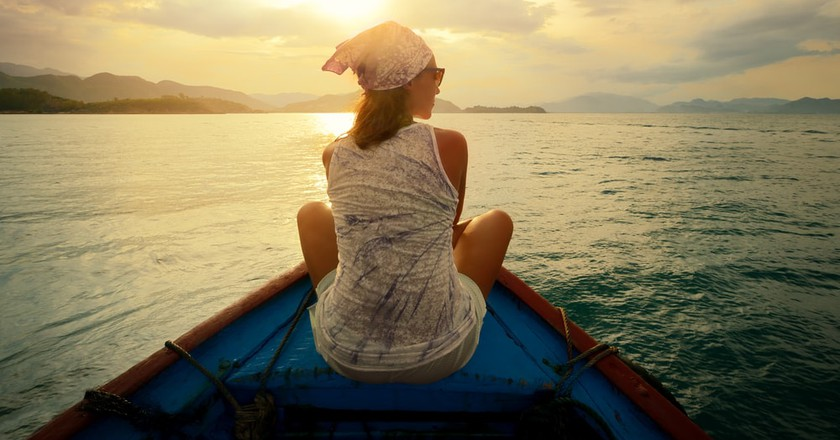 Traveling by boat at sunset | © soft_light/Shutterstock