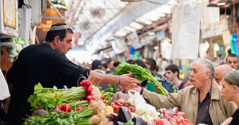 People shopping at Machane Yehuda Market, Jerusalem   © Alexey Stiop / Shutterstock