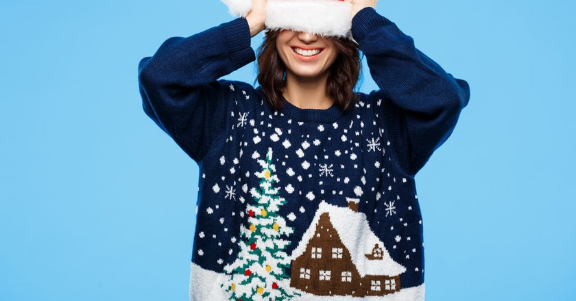 Ugly Christmas Sweater | © Cookie Studio/Shutterstock
