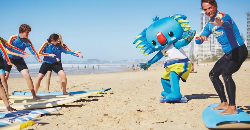 Borobi the Gold Coast 2018 mascot surfing | © TEQ