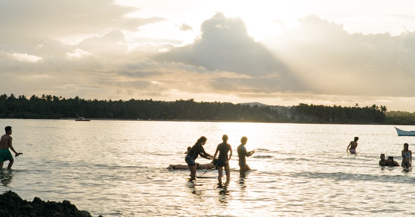 Sunset Surfing at Cloud 9 beach, Siargao, Philippines