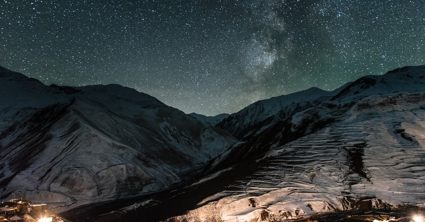 Starry night over the historical mountain village, Xinaliq   © Evgeny Eremeev/Shutterstock
