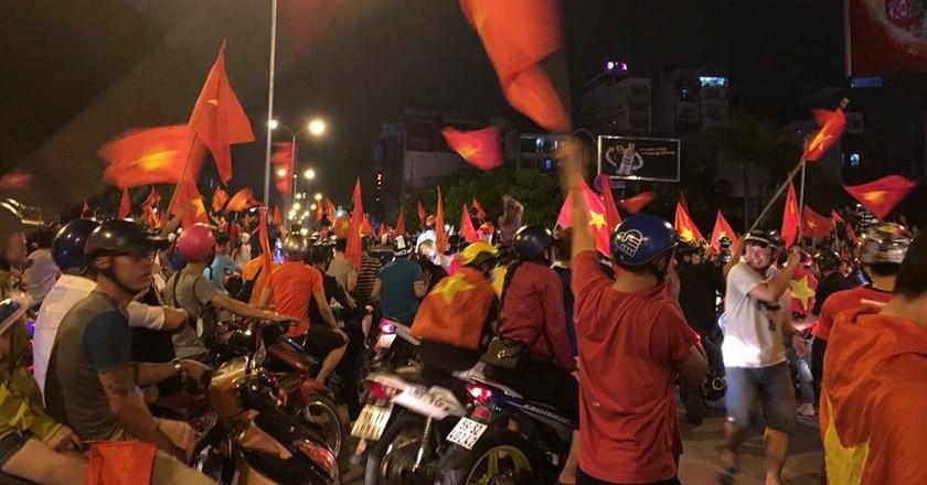 Vietnamese flags flying proudly   © Sasha Adams