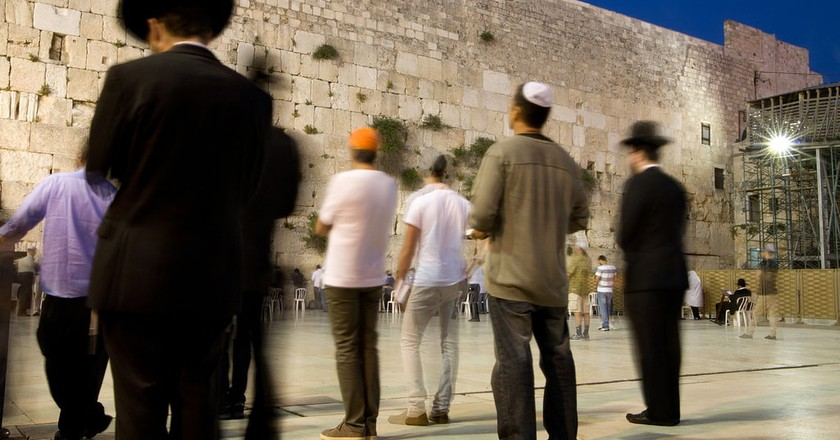 Men praying at the Western Wall, Jerusalem, Israel | © israeltourism / Flickr