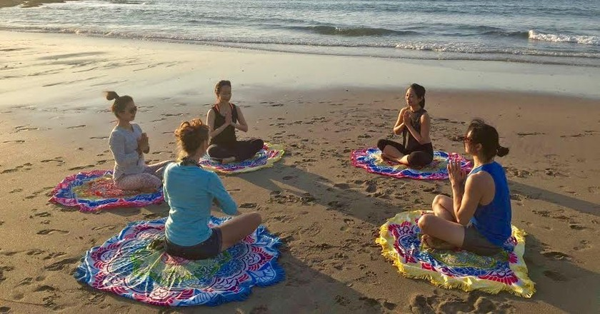 Yoga on the beach | Courtesy of Origin Yoga & Wellness Retreat