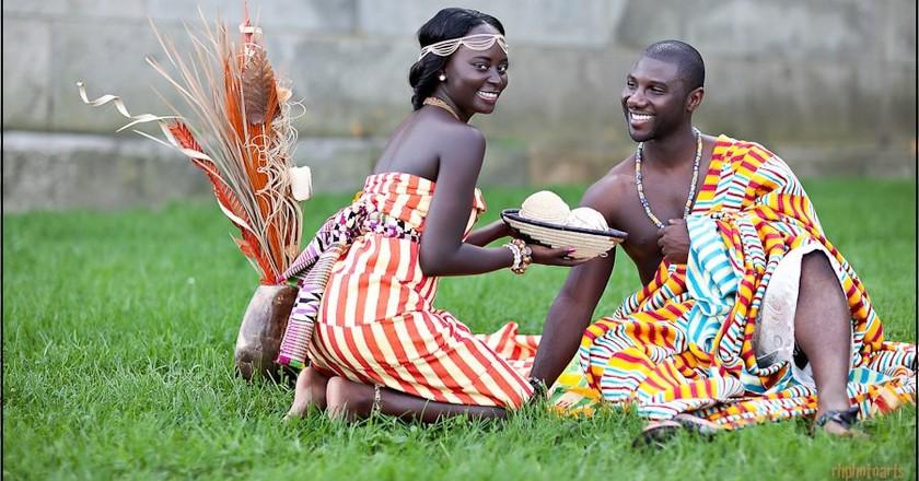 Bride and groom in kente slits