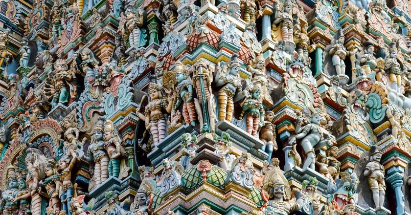 Elaborate carving on a gopuram or gateway tower of Madurai Meenakshi Temple