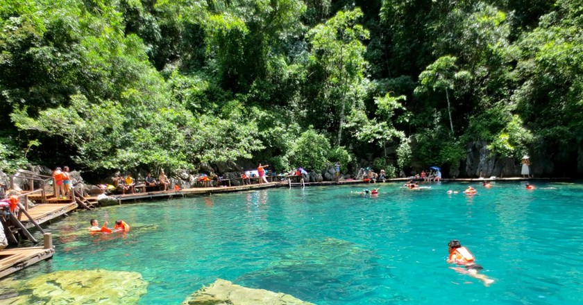 Tourists swimming in Kayangan Lake