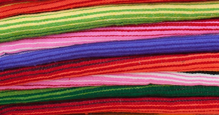Colorful textiles on sale in a Mexican market