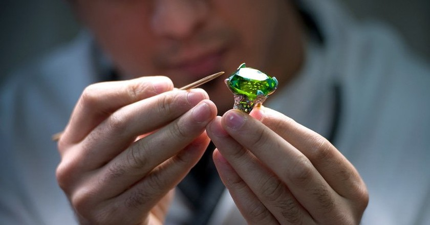 A jeweller working on a diamond ring.