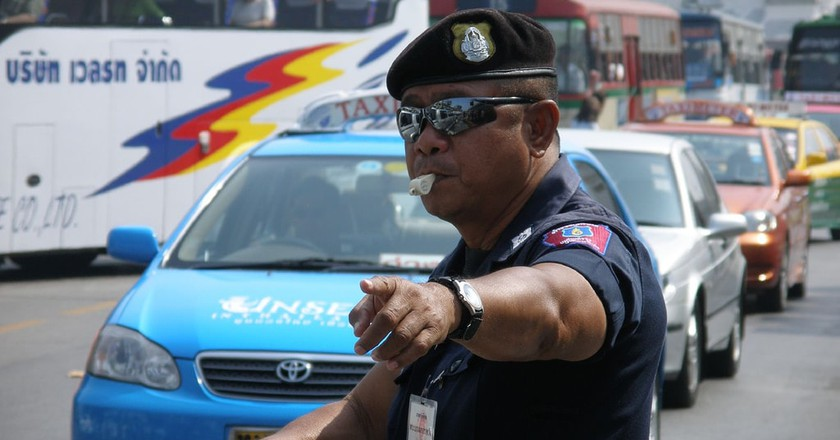 A Thai traffic policeman wearing sunglasses