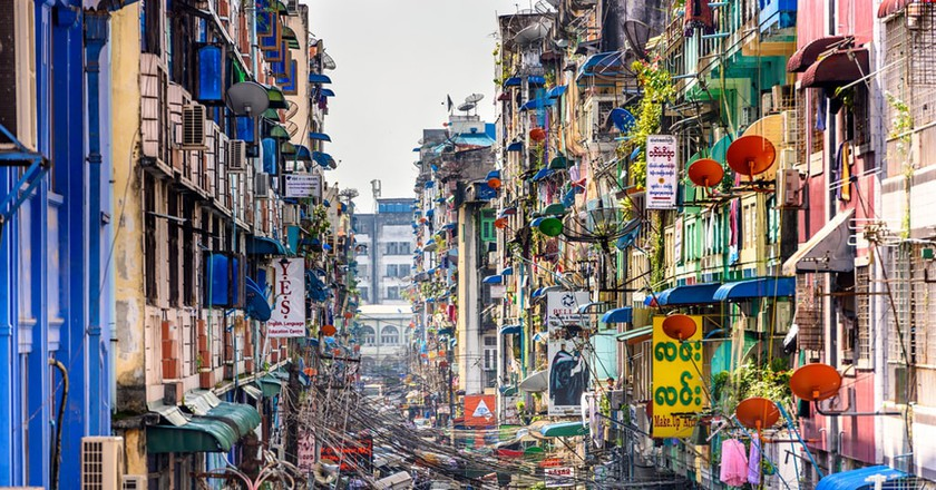 A congested, colorful alleyway in downtown Yangon, Myanmar | © Sean Pavone / Shutterstock