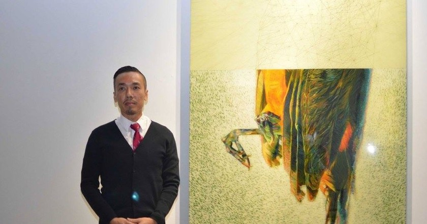 Ivan Lam with his artwork | © Wei-Ling / WikiCommons