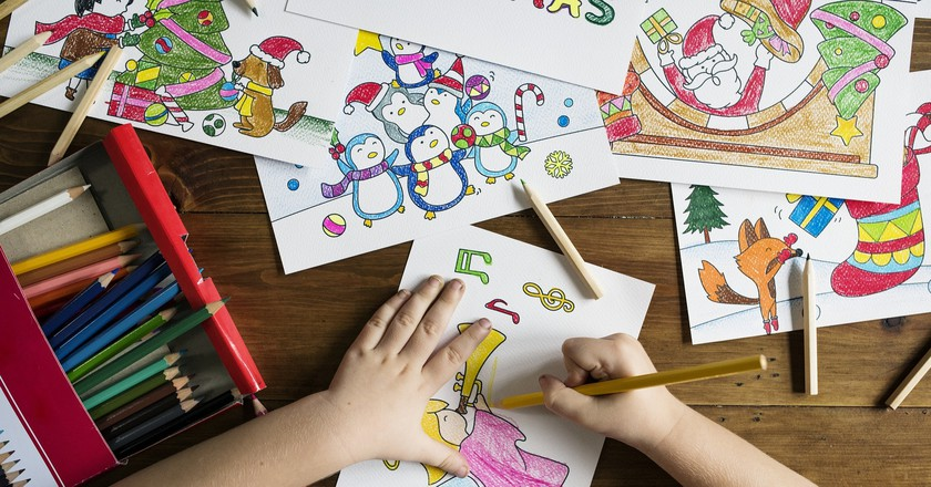Child drawing pictures at school