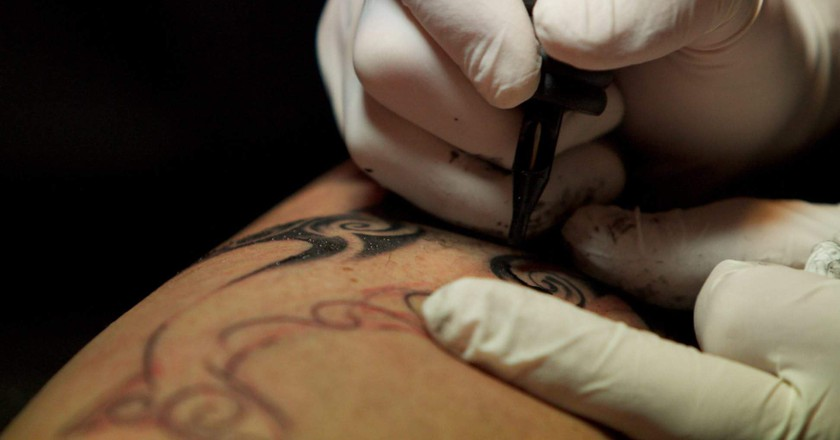 A tattoo session underway at the studio