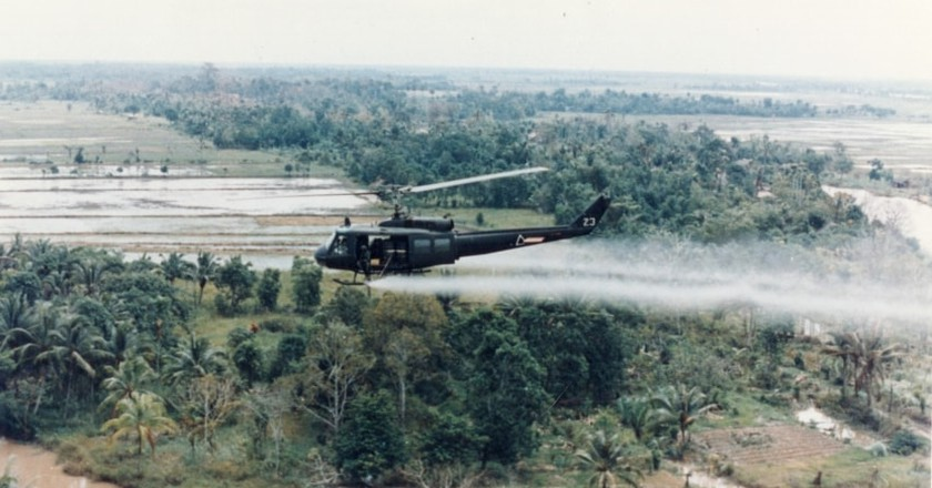 U.S. Huey helicopter spraying Agent Orange in Vietnam